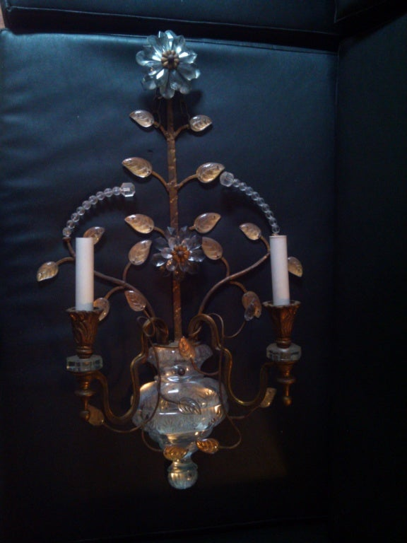 A large pair of Bagues sconces with cut crystal body