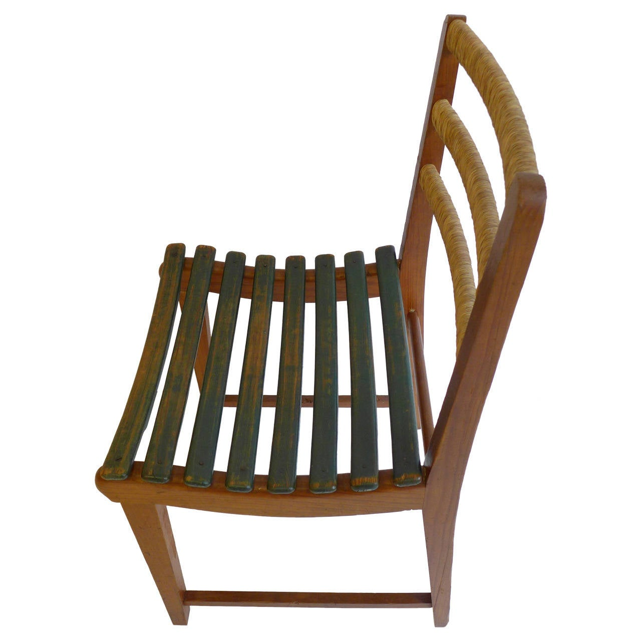 Modernist chair of pine with curved and painted wood slats and rush-wrapped back rails. Designed by Michael van Beuren for his company, Domus, and produced in Mexico, circa 1947. Born in New York City, van Beuren (1911-2004) studied at the Bauhaus