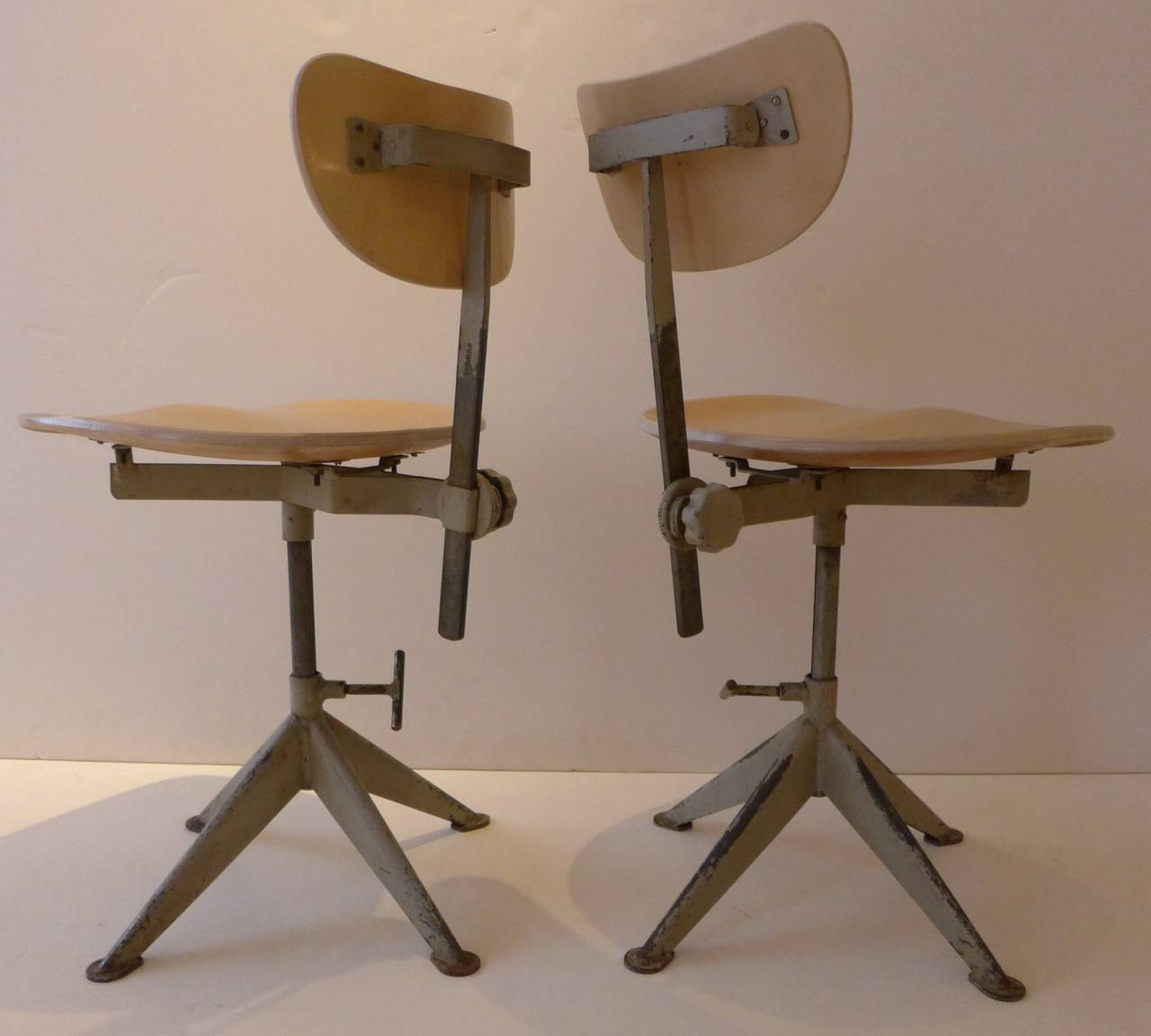 Two work chairs of molded birch plywood and painted steel by the Swedish metalworking firm of Odelberg Olsen, produced circa 1948, for distribution by Knoll in the U.S. market. The chair, which references Prouve, is shown in the 1948 Knoll catalog