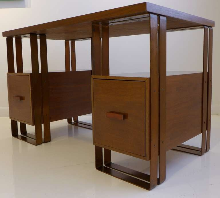 Rare desk in walnut and banded copper-plated aluminum, designed by Donald Deskey and produced by Ypsilanti Reed Furniture Company, circa 1929. A strong statement of Machine Age aesthetics, rare to the market. Ref: David Hanks,