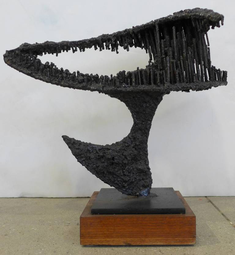 Direct metal sculpture with textured and patinated surface by Des Moines, Iowa, artist James Anthony Bearden. Titled