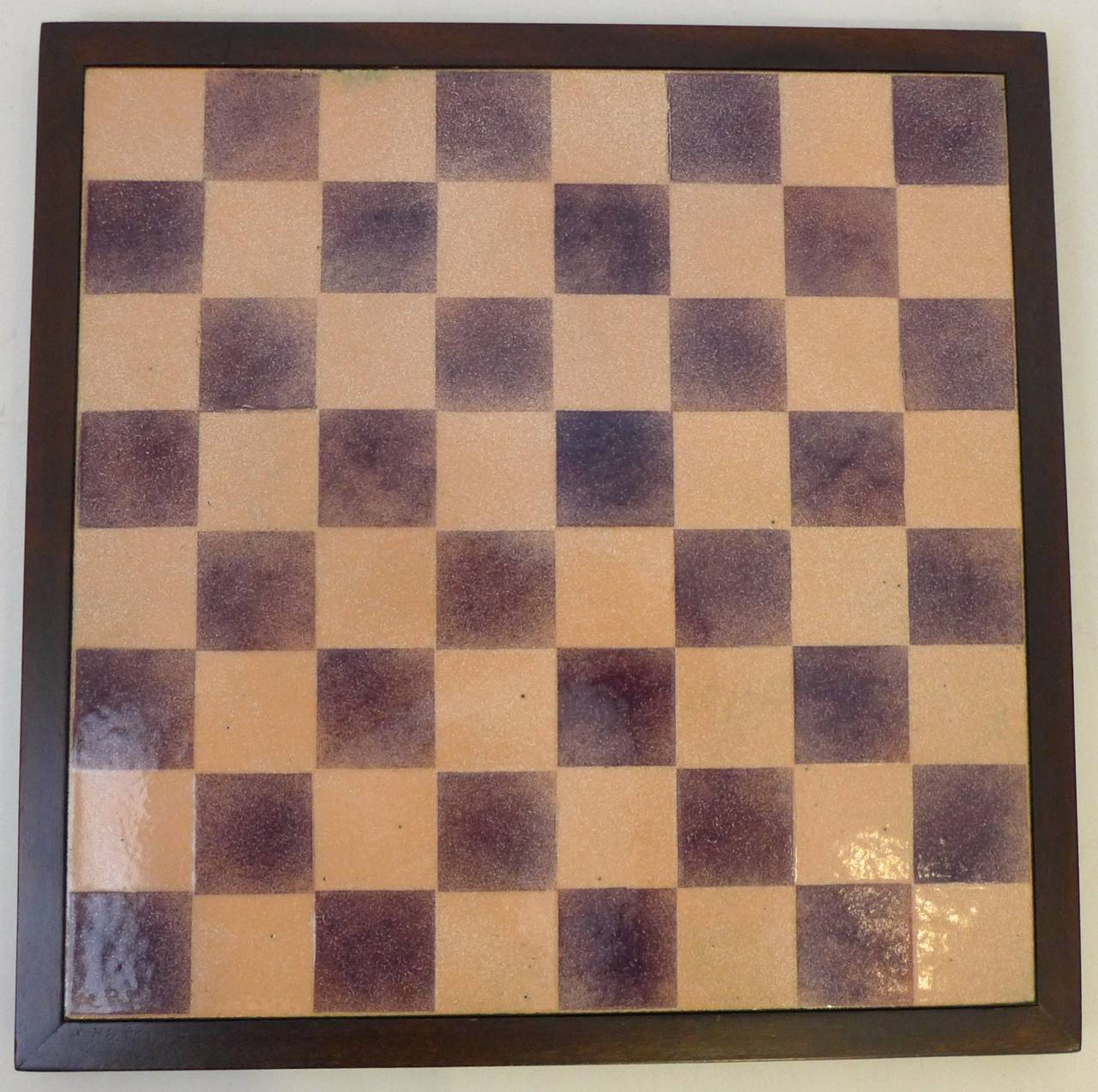 Enameled copper chessboard with dark walnut frame and felted back by Italian painter and master enamelist Paolo De Poli. Beautifully orchestrated colors in variegated purple and peach enamel with iridescent flecks of gold. In excellent original