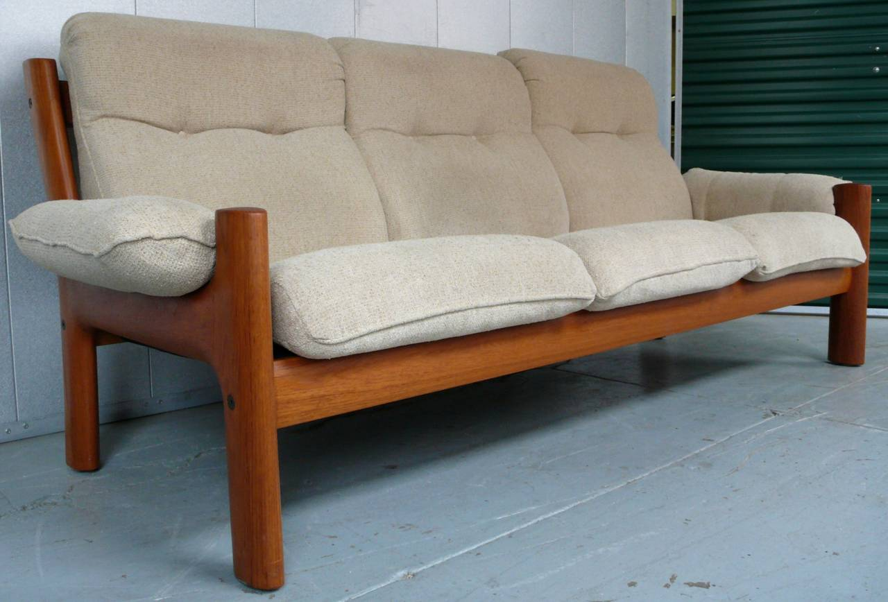 Three Seat Sofa With Sculptural Solid Teak Frame And Vintage Fabric.  Produced By J.E.