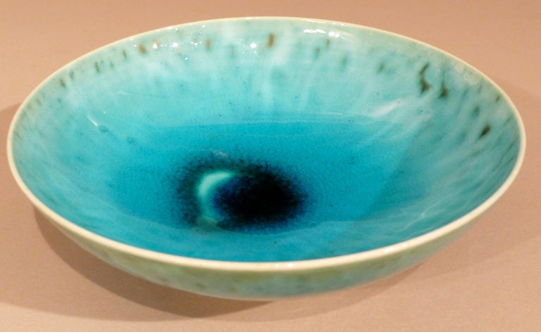 Shallow porcelain bowl with turquoise and green multi-chromatic glaze by Austrian born and educated ceramist Friedl Holzer-Kjellberg. One of the first artists-in-residence at Finland's Arabia factory, Kjellberg's career spanned the years 1924-1970,