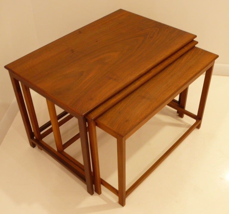Rare nest of three solid teak tables designed and fabricated by Danish master cabinetmaker Jacob Kjaer (1896-1957). Kjaer's use of the finest materials and handcrafted construction methods placed him on the top tier of Danish workshops, along with