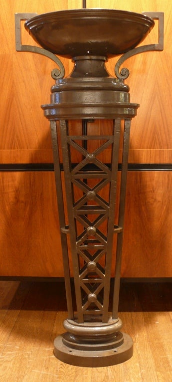 Pair of French cast-iron columns, circa 1940s. Tall, oval, neoclassical forms can be used as jardinières or wired as lights. Price is for pair.