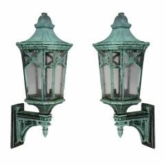 An antique pair of large exterior wall lanterns
