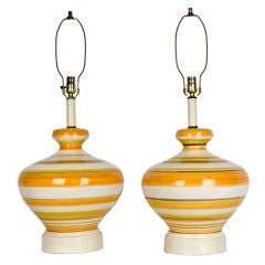 Mid-century ceramic lamps with orange, yellow, and pale green stripe, circa 1960