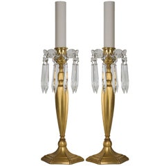 A pair of Sterling Bronze Co. candlesticks
