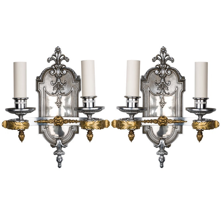 A Pair Of Chrome And Brass Sconces