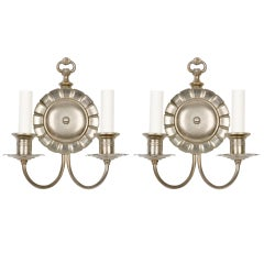 A Pair Of Aged Nickel Sconces