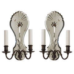 A Pair Of Wheel-cut Mirrored Sconces
