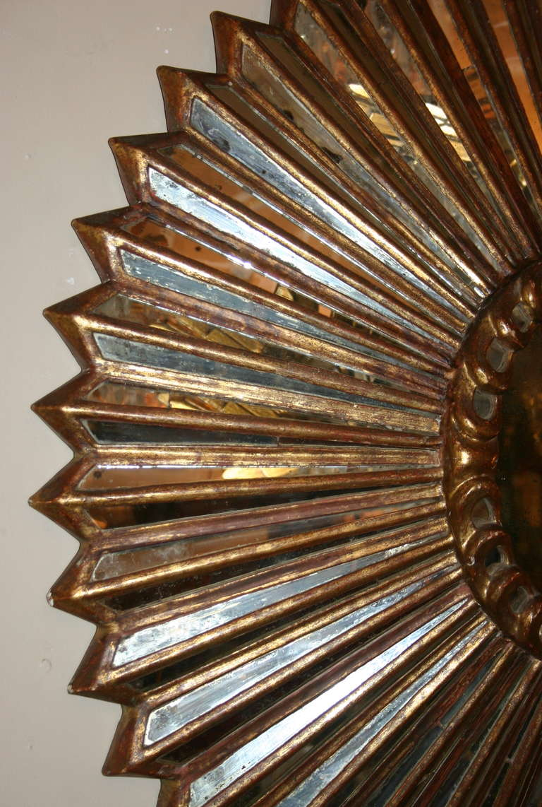 Colonial Revival Carved Giltwood Sunburst Mirror For Sale