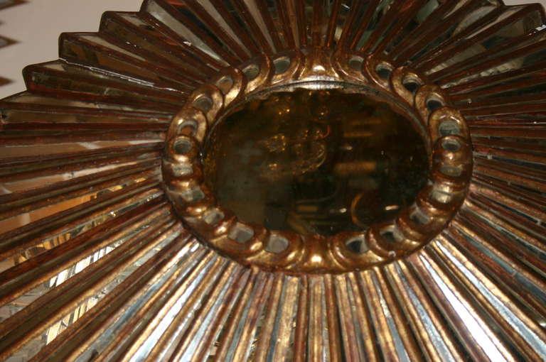 Spanish Carved Giltwood Sunburst Mirror For Sale