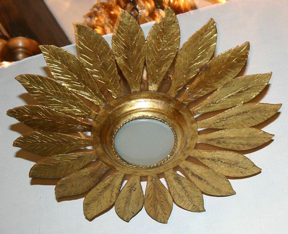 French gilt metal sunburst light fixture with original patina, circa 1940. Measures: 18