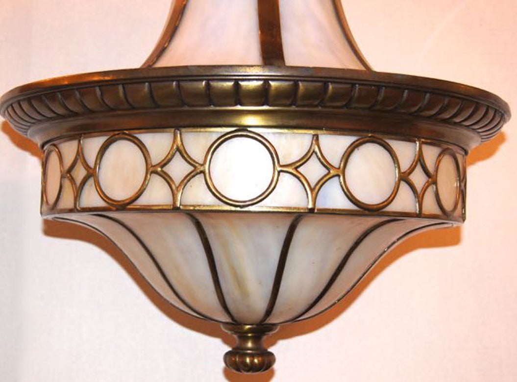 An American leaded glass light fixture with interior lights, circa 1910. Finely cast details.
