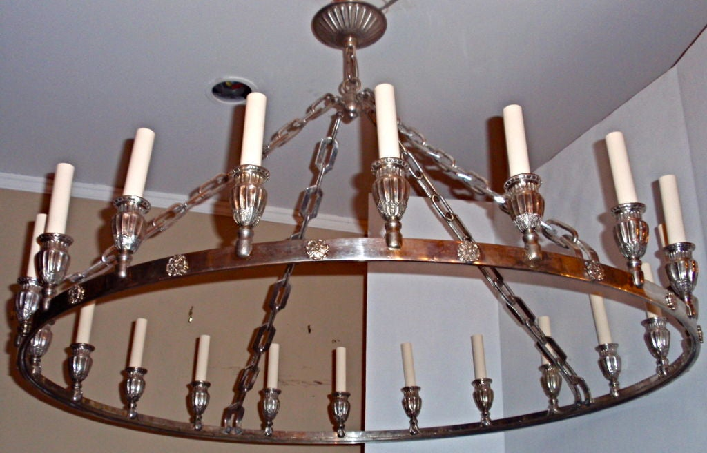 A circa 1920s silver plated neoclassic style chandelier with original finish. 20 lights.  Measurements: Height 28? drop Diameter 40?.