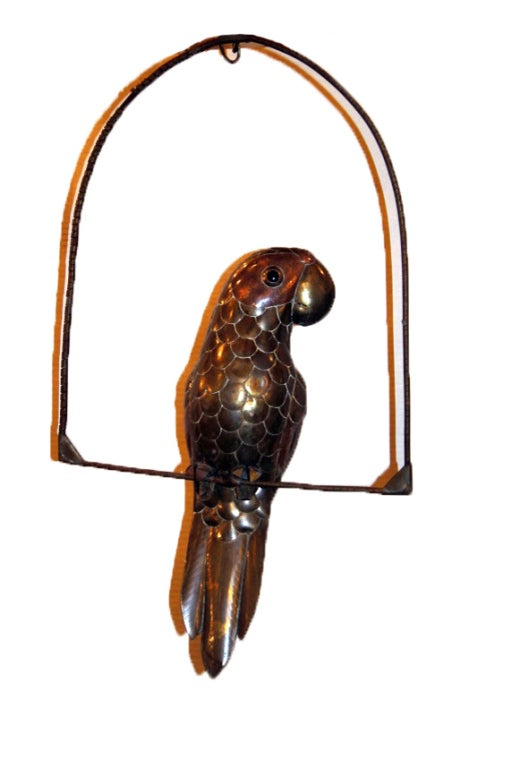 A circa 1960s hanging metal parrot sculpture.  Measurements: Height 30