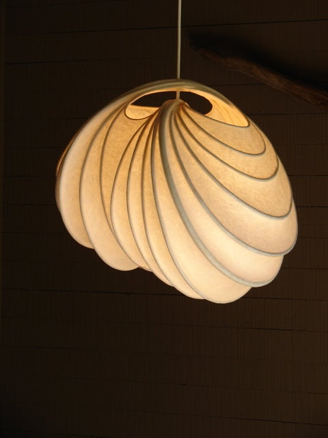 Beautifully illuminated one of a kind handmade light sculpture.