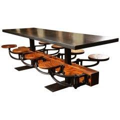 Eight Seat Communal Steel Top Dining Table with Cast Iron Attached Swing Seats