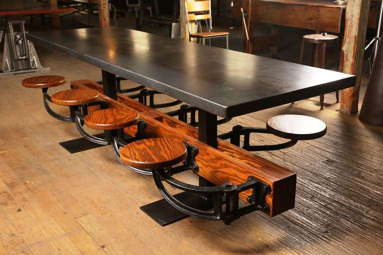 American Eight Seat Communal Steel Top Dining Table with Cast Iron Attached Swing Seats For Sale