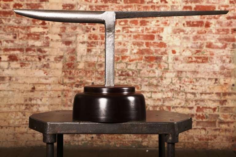 Vintage Industrial, large anvil on wooden base.
