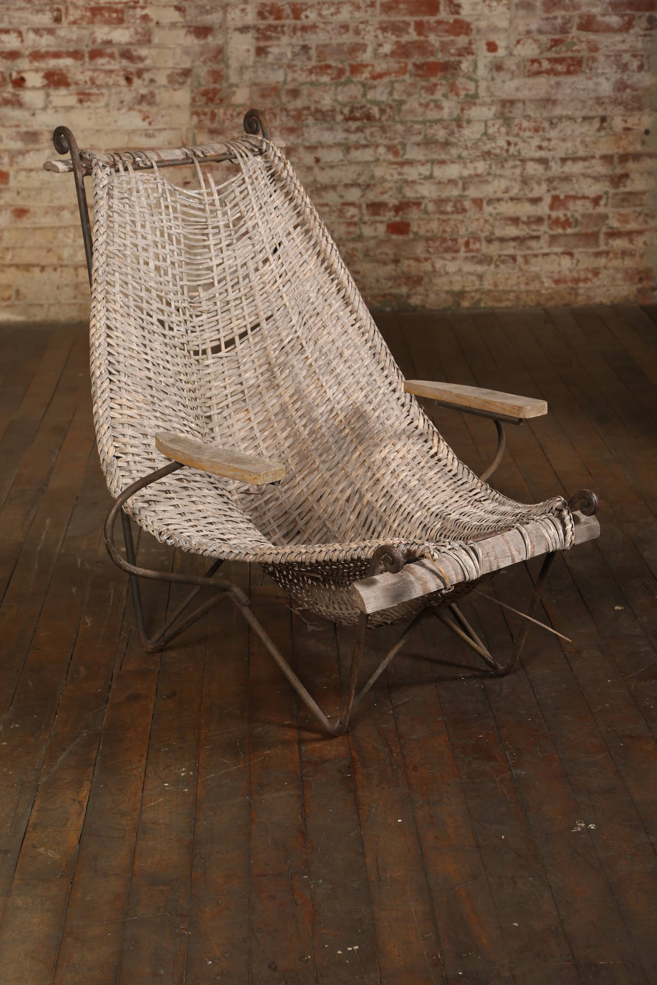"Original vintage mid-century modern rare John Risley wicker lounge chair. This lounge chair comes with arms and is in ""as found"" condition."
