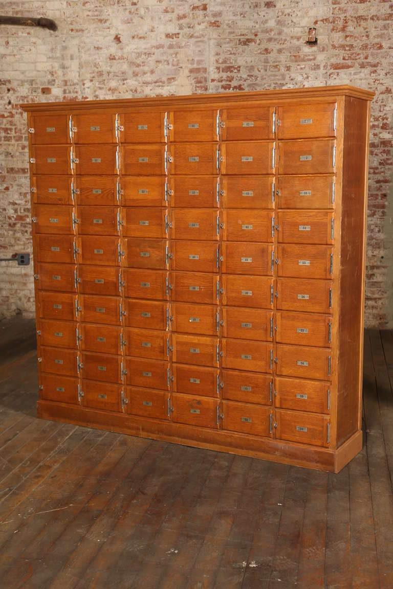 Beautiful vintage industrial wood storage cabinet pigeon hole or locker style with numbered doors and