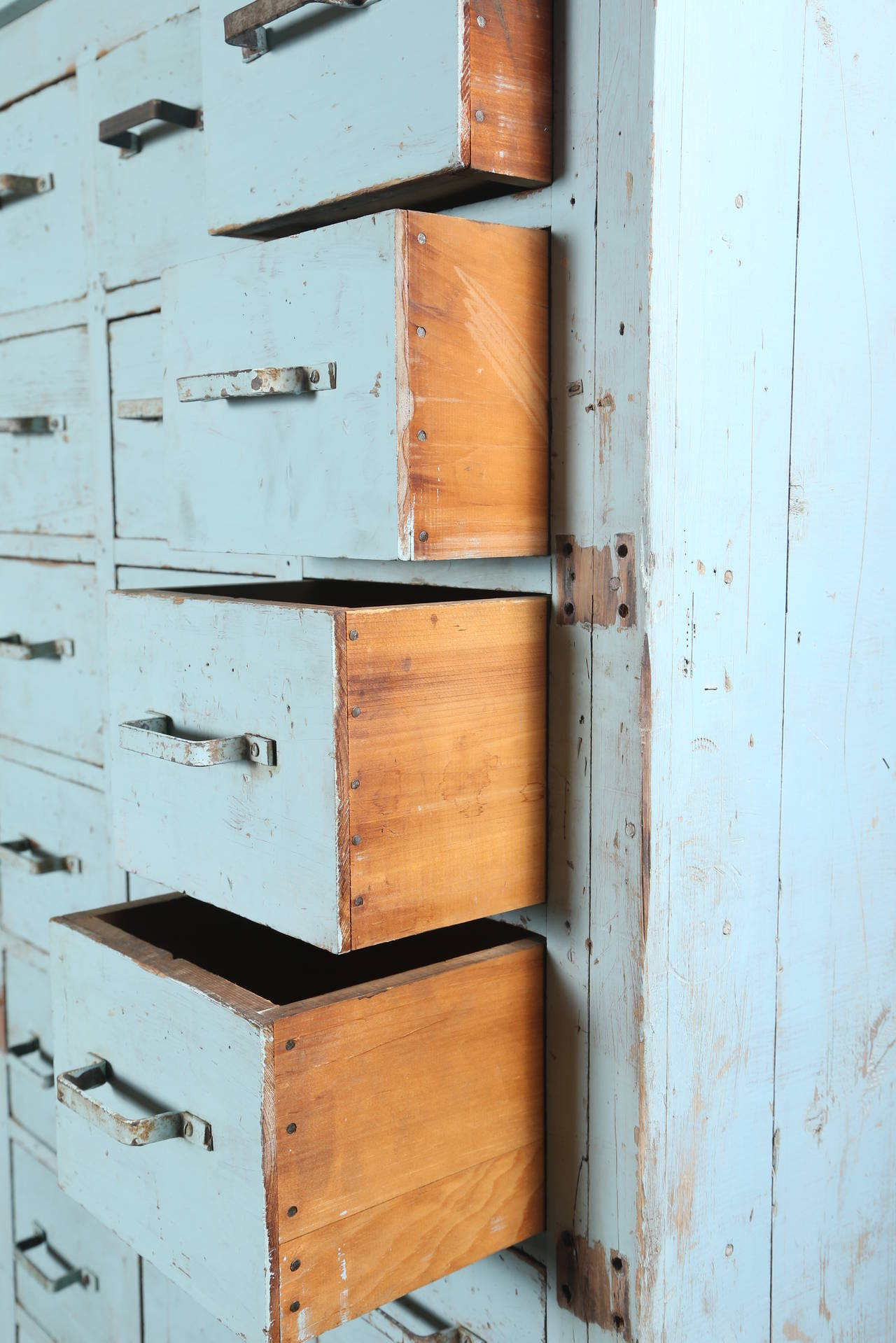Vintage Multi-Drawer Wooden Storage Rolling Apothecary Distressed Cabinet In Distressed Condition For Sale In Oakville, CT