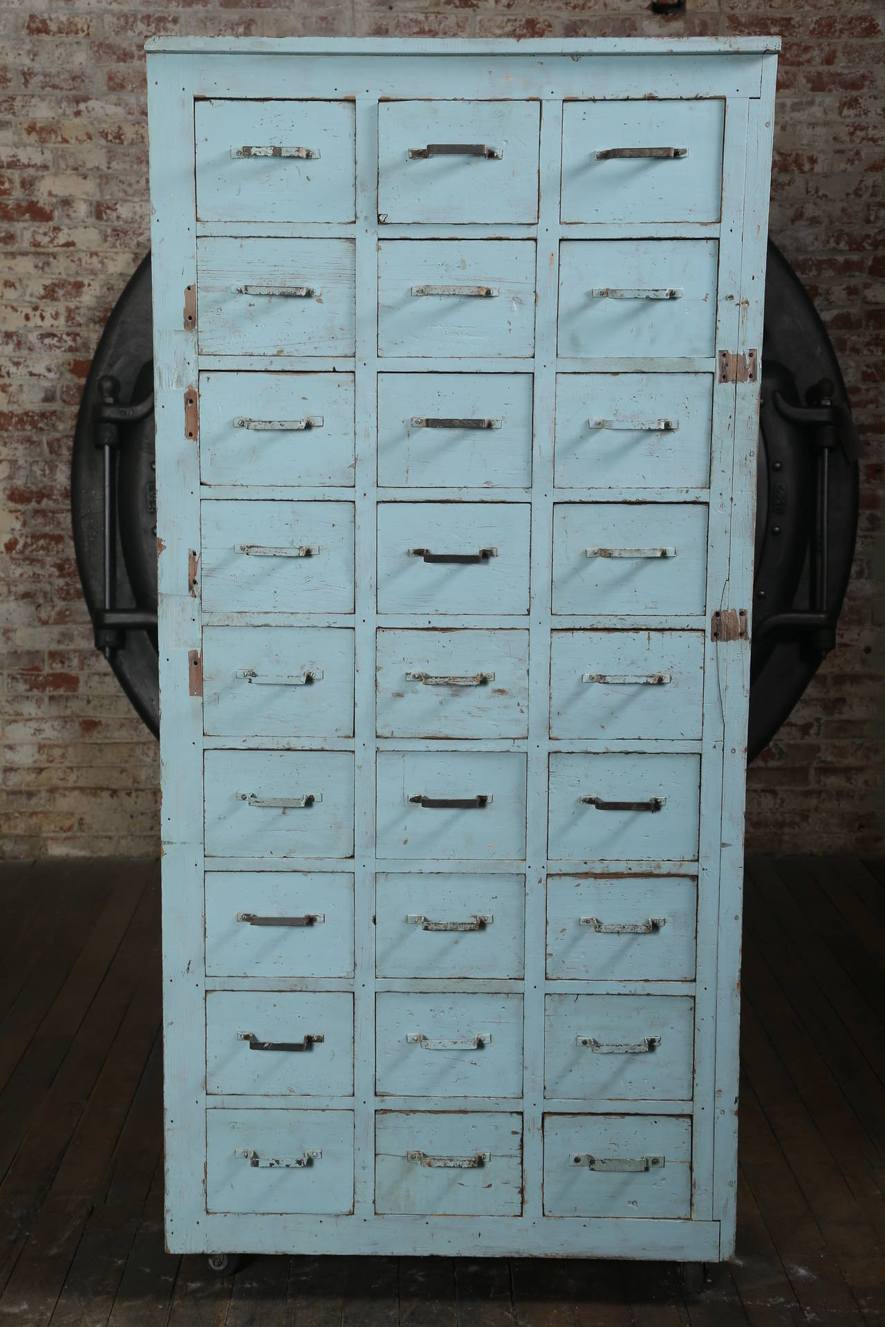 20th Century Vintage Multi-Drawer Wooden Storage Rolling Apothecary Distressed Cabinet For Sale