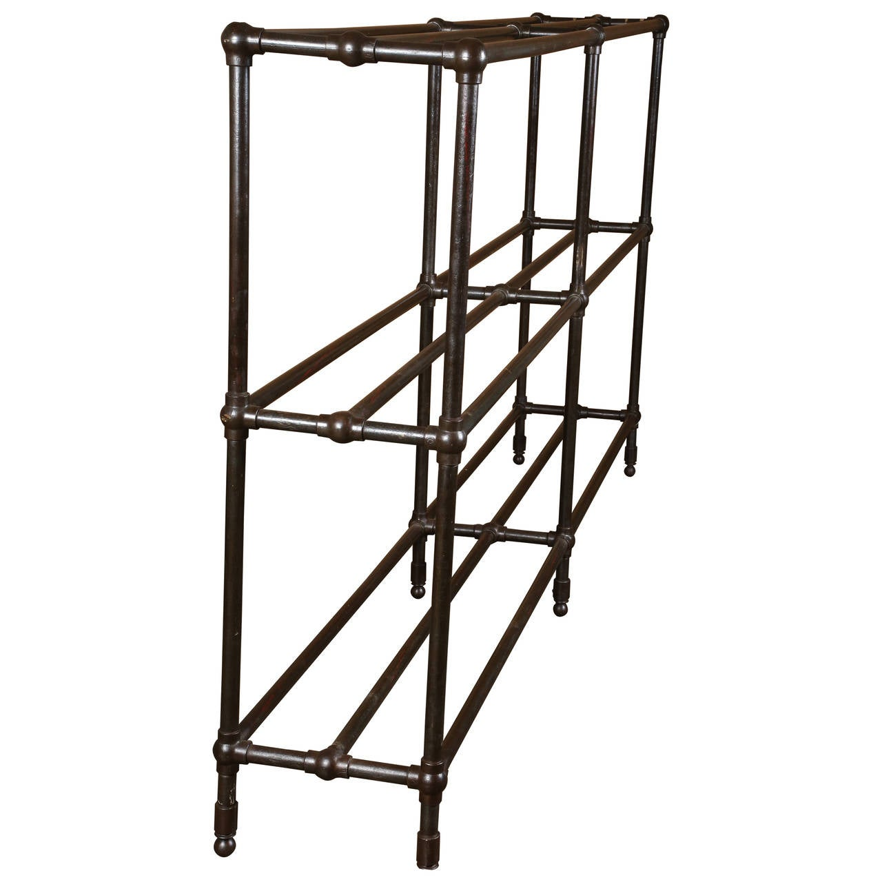 Vintage Industrial steel pipe shelving unit with steel poles and cast iron ball joints.