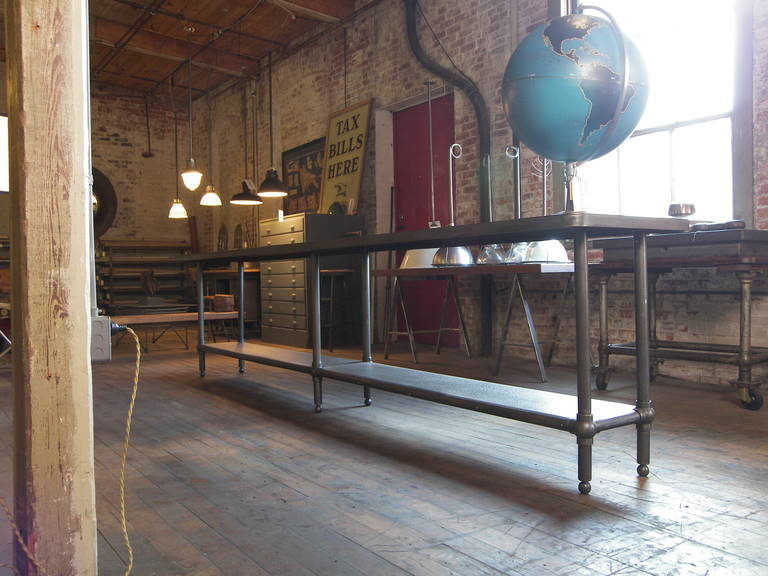 12 foot long authentic vintage Industrial steel and cast iron work / console table / retail display storage rack. Table measures 144