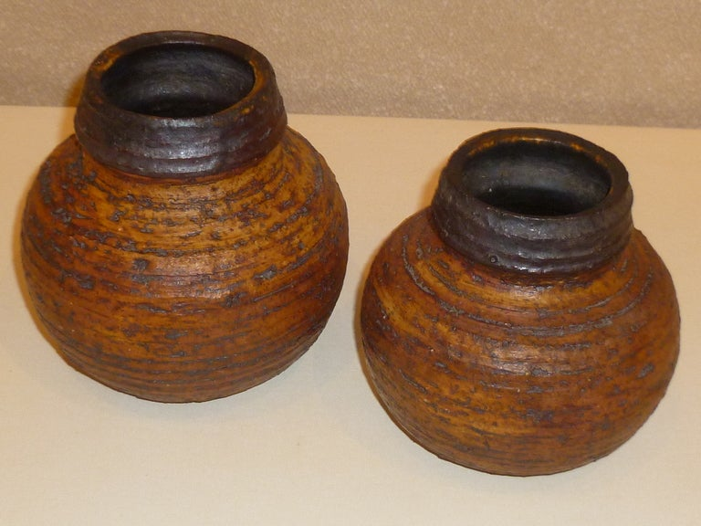 An exceptionally organic and naturalistic pair of hand thrown studio vases by Auli Heinonen for Arabia, circa 1960. Stengods or stoneware, they have a very textured chamotte technique employed in their creation. Exciting and warm and cute actually