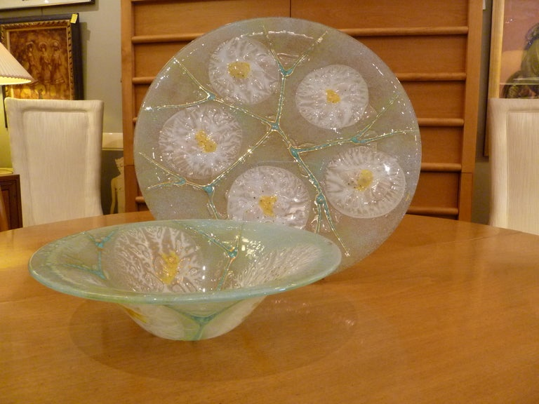 Reduced from $1150.... Delightful fused glass charger and bowl group by Michael & Frances Higgins with stylised florals with stems highlighted in gilt. Both signed with gilt stamp.    Price is for the pair.  Measurements: Charger 17""