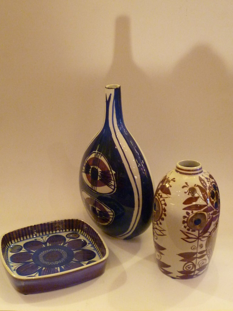 This grouping of three faience pieces from the Royal Copenhagen / Aluminia line Tenera designed by Nils Thorssen in the 1960s has a wonderful aura. These three were decorated with organic stylized floral motifs by three women artists, all Danes and