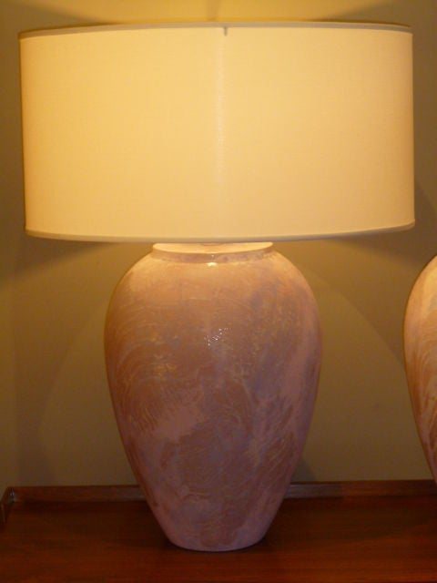 Reduced for SATURDAY SALE from $1500.....Large in form and uniqueness, this pair of oil jar form table lamps have a wonderful very textured glaze and a myriad array of soft swirled colors from white to blue to pink to purple and in between. Very