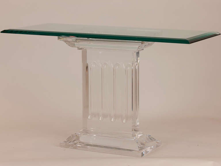 Magnificent pair of French Neoclassic lucite and Glass side tables with column detail.