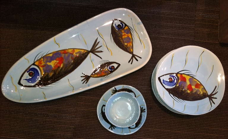 Set of 12 stamped French Ceramic dishes by Pornic.  Service includes 10 dinner plates, sauce and platter