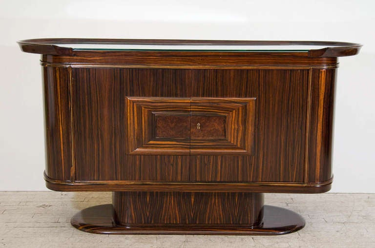 Beautiful bar or serving cabinet in a streamlined Art Moderne style. A versatile piece that can be used as a small credenza or media cabinet. Please contact for location. Offered by Las Venus by Kenneth Clark, New York City.