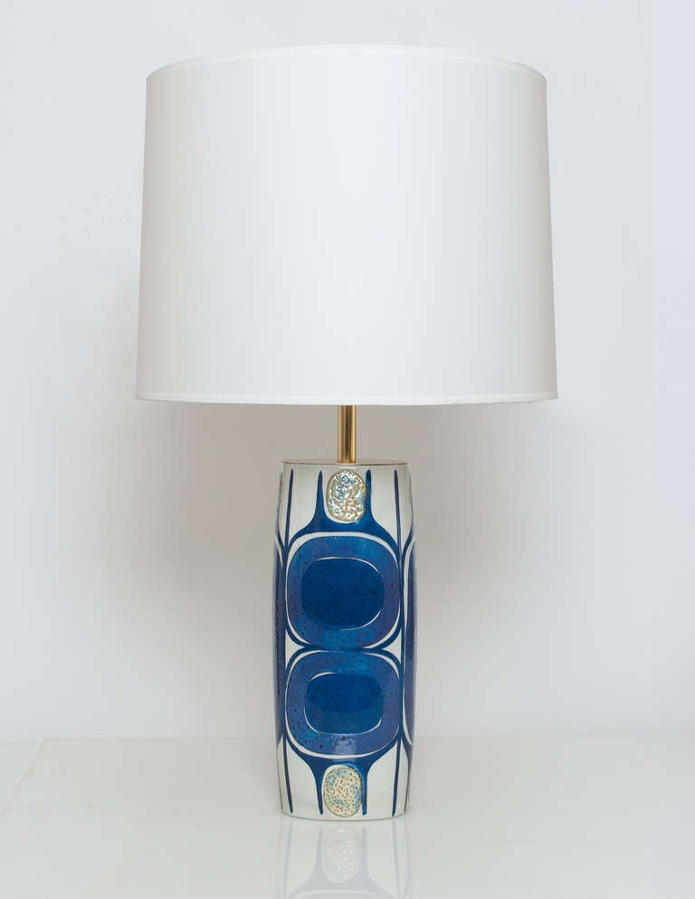 Pair of Danish Mid Century Modern porcelain lamps designed by Inge-Lise Koefoed for Aluminia in 1961. The base is a soft oval shape and the surface is treated with a variety of glazes and techniques. Newly restored brass and electrified for the USA