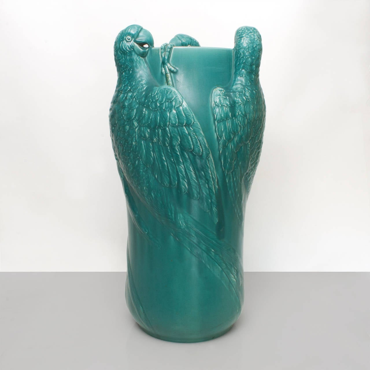 Large remarkable Swedish ceramic umbrella stand or floor vase decorated with three lifesize parrots. Designed by Alf Wallander for Rörstrand, circa 1900s.