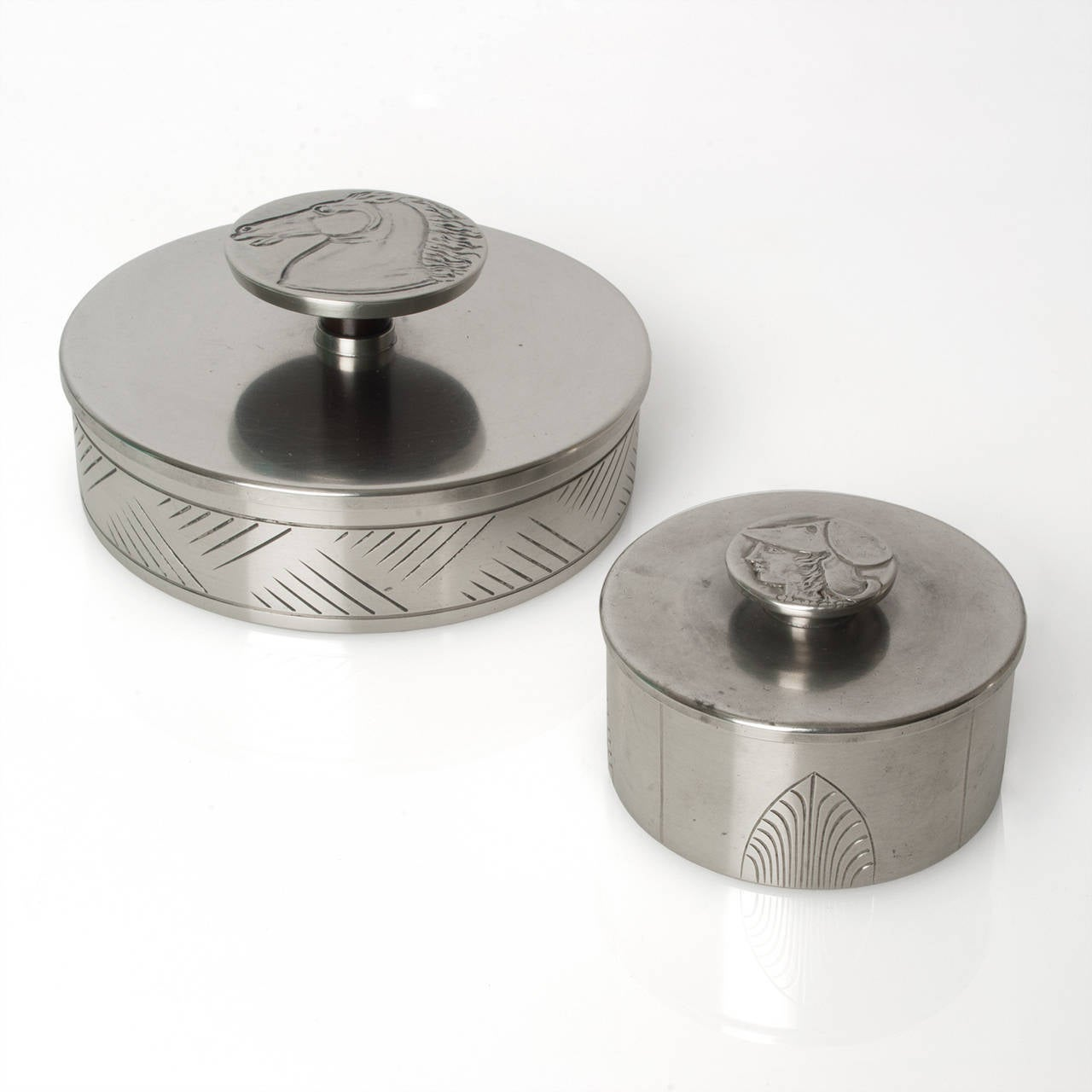 Two Swedish art deco pewter boxes designed by Oscar Antonsson for Ystad Metall. These pieces are from the