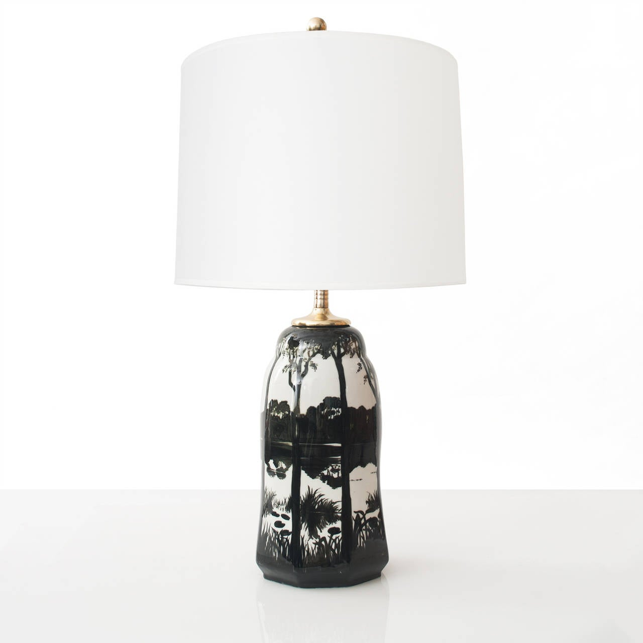 Swedish early 20th century glazed ceramic table lamp with a black and white lake scene over a hexagonal shaped form. Designed and signed by Knut Hallgren, marked ALP Lidkoping, 1918. Newly electrified with on standard socket for use in the USA, and