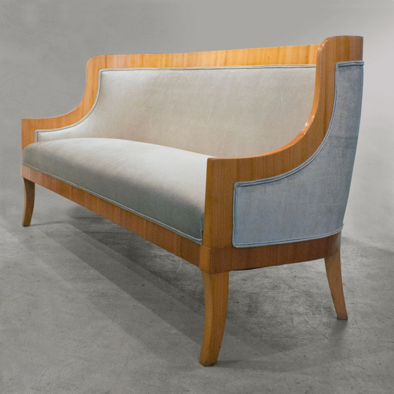 Elegant Swedish Art Deco sofa designed by architect Carl Bergsten for the luxury ocean liner M/S Kungsholm, matching chairs also available. The chairs are documented in the 1928 photograph of one of the Kungsholm's reading rooms. Sofa is elm wood