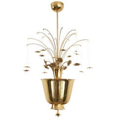 Paavo Tynell chandelier of pierced brass, with cast and formed brass flowers