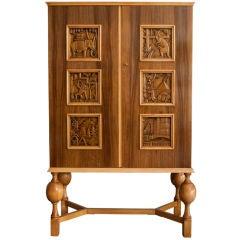 Swedish Art Deco 2-door cabinet with carved panels Eugen Hoglund