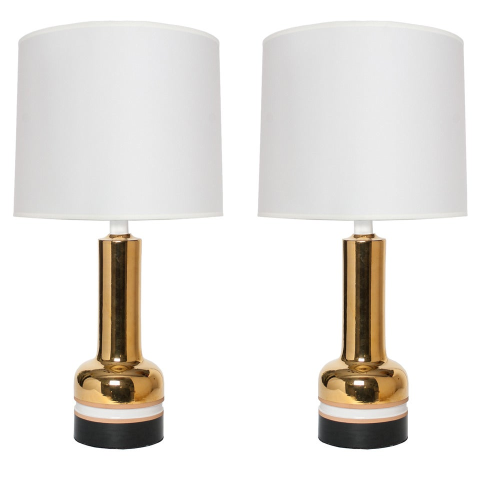 Pair of Scandinavian Modern gold ceramic lamps from Bergboms.