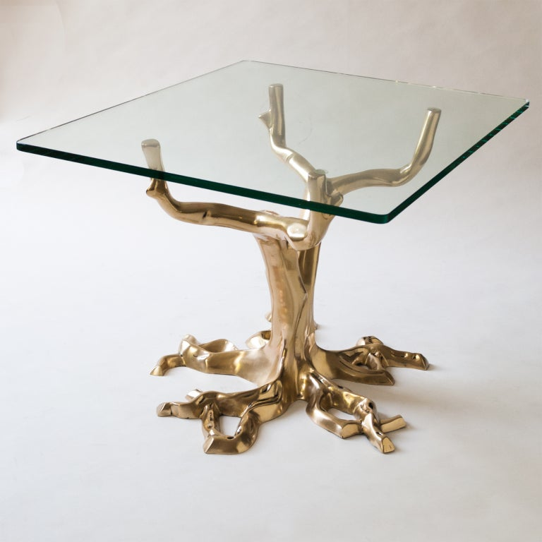 Fabulous pair of side tables with bases made from polished cast bronze artistically rendered in the form of a tree with four branches as supports for the glass top. Possibly French designed in the manner of Fred Brouard, circa 1970. Bases have been