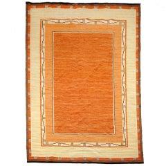 "Swedish Art Deco flat weave ""Rolakan"" rug in warm tones."