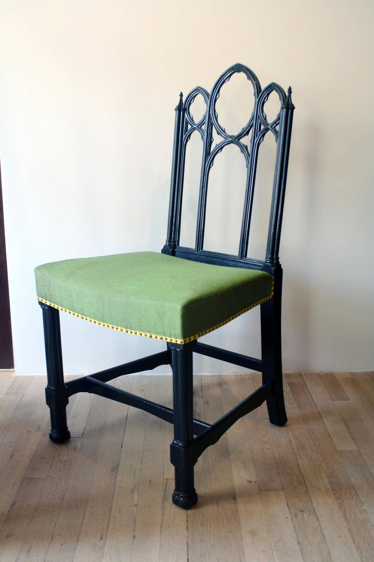 Set of four ebonized Gothic side chairs. Label from Irving & Casson - A.H. Davenport, Co., Boston and New York.